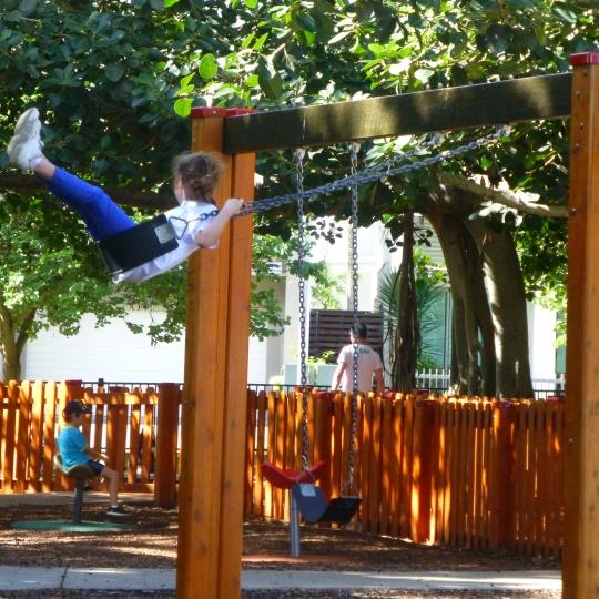 Violet on the swings